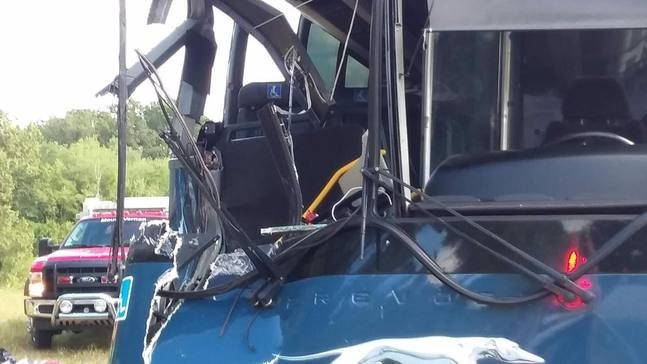 At least 17 injured in crash between truck and Greyhound bus